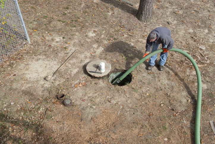 Man Cleans Home Septic Tank